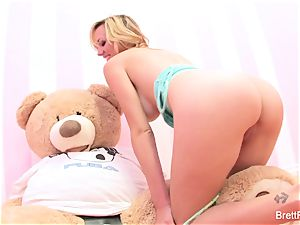 Brett Rossi plays with a wedged bear's strap-on faux-cock