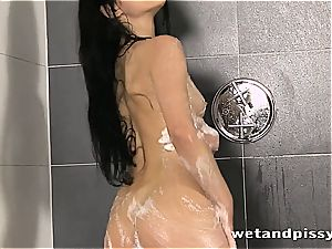 brown-haired princess in the bathtub frolicking with her bod