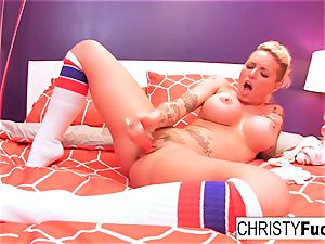 Christy uses a toy on her tight snatch